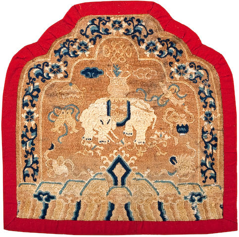Throne-back rug with central design of an elephant with vase surrounded by Buddhist symbols. Plum Blossoms