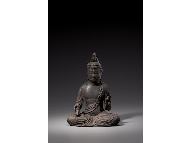 Wood sculpture of a seated Buddha 12th century