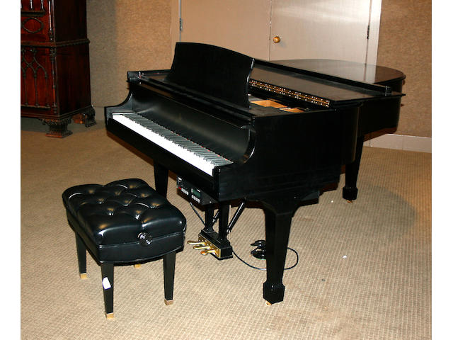 A Steinway grand piano with built in player