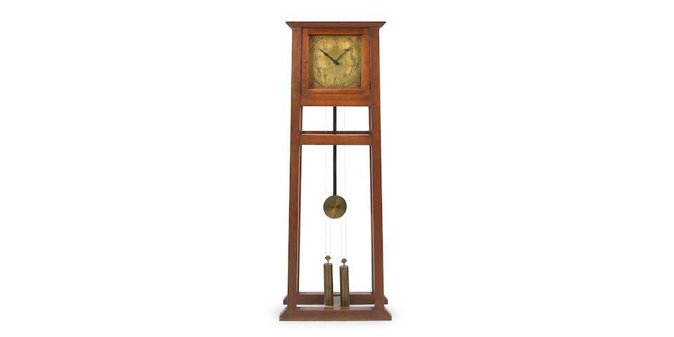 A rare Gustav Stickley oak and copper tall case clock