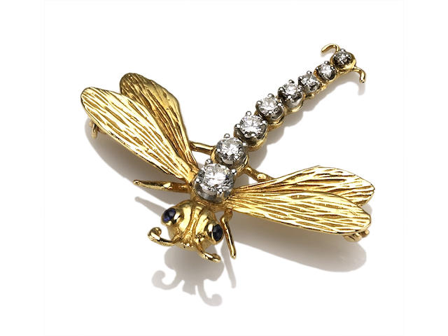 A diamond, sapphire and eighteen karat gold dragonfly brooch