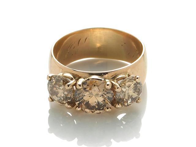 A colored diamond three stone ring