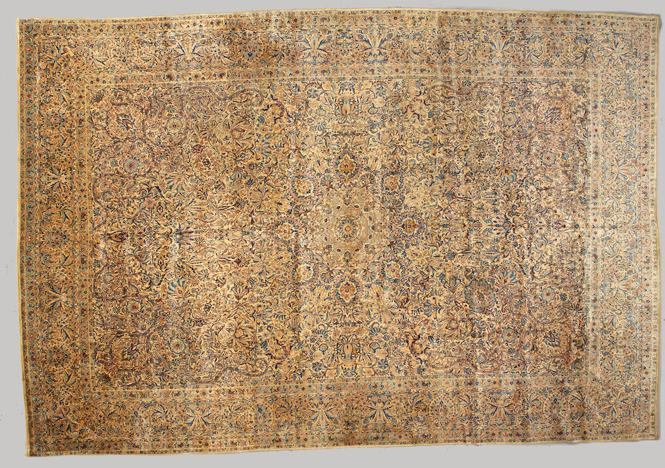 A Kerman carpet South Central Persia size approximately 12ft. 8in. x 22ft. 4in.