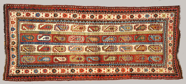A Kazak runner Caucasus size approximately 3ft. 11in. x 8ft. 6in.