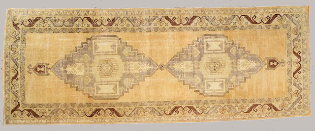 An Oushak runner Anatolia, size approximately 4ft. 10in. x 12ft. 8in.
