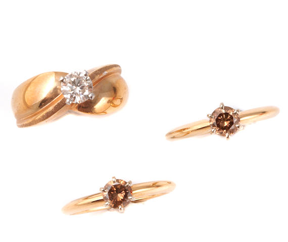 A collection of five brown diamond and gold solitaire rings together with one brown diamond and gold pendant