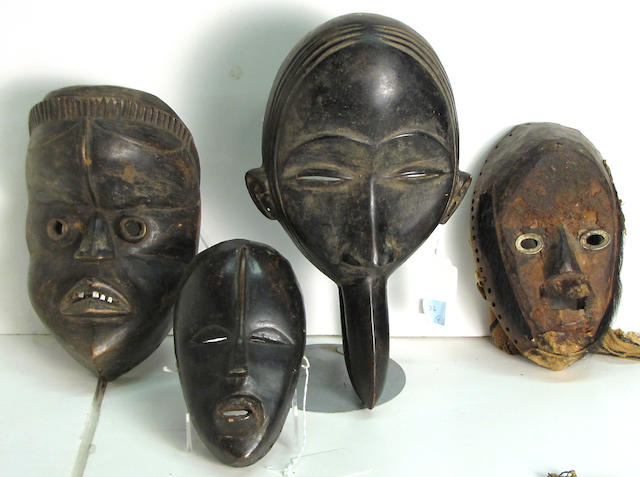 Four Dan masks, Liberia