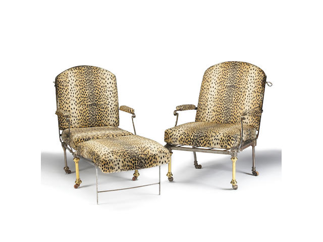 A pair of polished steel and brass reclining armchairs