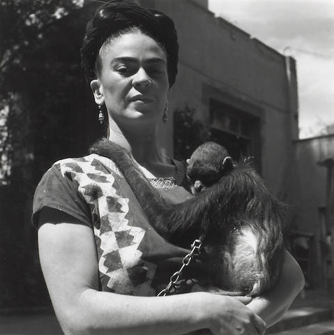 Fritz Henle (German, 1909-1993); Frida Kahlo with her pet monkey in front of her studio in Coyoacan, Mexico;