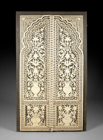 A pair of Anglo Indian painted carved bone paneled doors  late 19th/early 20th century