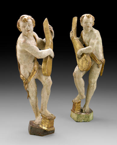A pair of Northern Italian gilt and painted wood figures of musicians  18th century