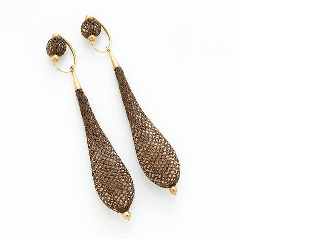 A pair of woven hair, 14k gold day and night earrings