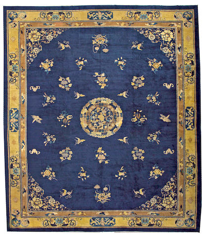 A Chinese carpet China, size approximately 12ft. 5in. x 14ft. 4in.