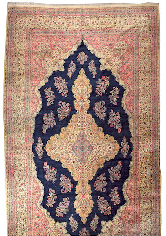 A Kerman carpet size approximately 12ft. 8in. x 22ft. 4in.