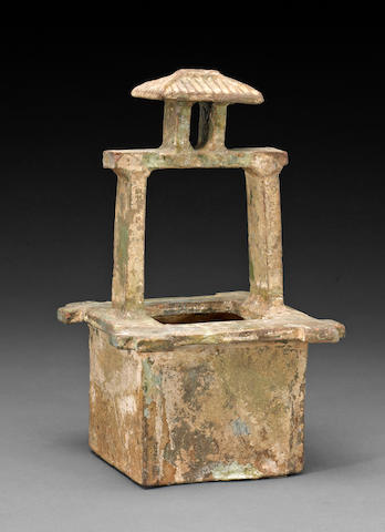 A Chinese glazed earthenware model of a wellhead, Han Dynasty