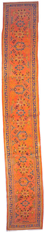 An Oushak runner Anatolia, size approximately 3ft. x 18ft. 10in.