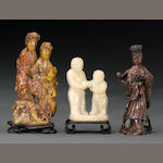 A group of three soapstone figural carvings