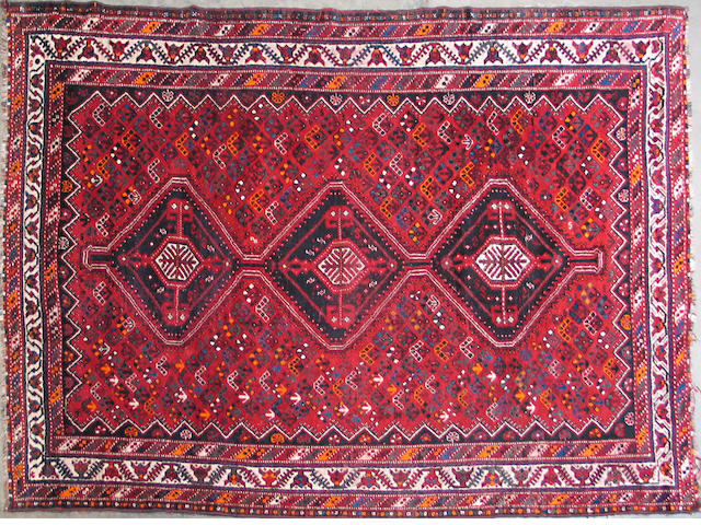 A Southwest Persian carpet size approximately 7ft. 1in. x 10ft. 4in.