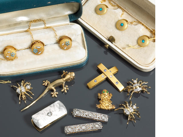A collection of enamel, diamond, sapphire, platinum, 18k and 14k gold jewelry