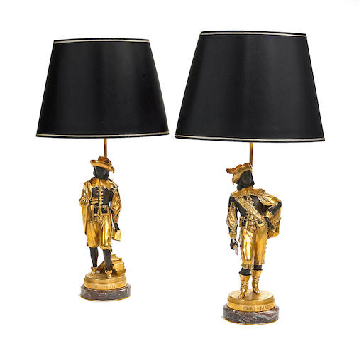 A pair of French gilt and patinated bronze figures, now as table lamps <br>E. Quesnel Foundry <br>late 19th century