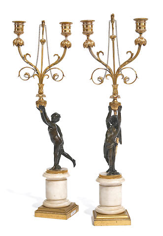 A pair of Louis XVI style gilt, patinated bronze and marble figural two light candelabra 19th century
