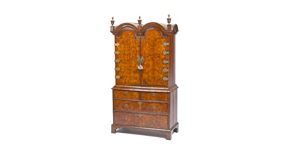 A good Queen Anne walnut double dome cabinet on chest  early 18th century