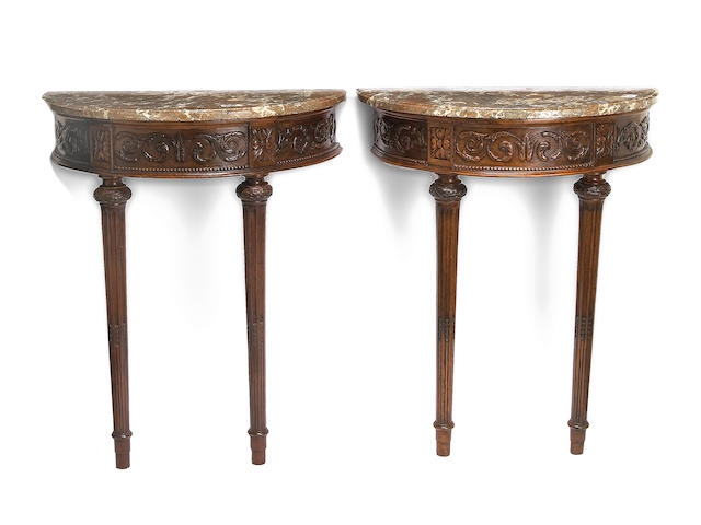 A pair of Louis XVI walnut consoles d'applique <br>fourth quarter 18th century