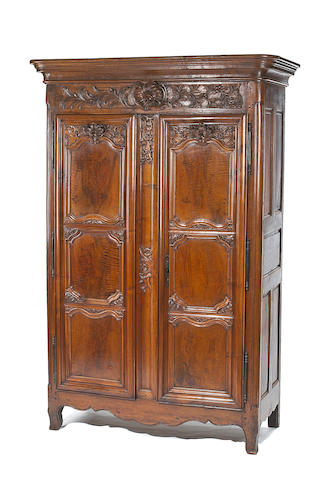 A fine Louis XV  walnut armoire  third quarter 18th century