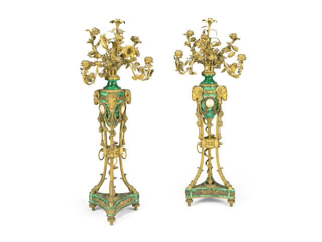 A pair of large Louis XVI style gilt bronze and malachite veneered seven light candelabra  after the model by Pierre-Philippe Thomire 19th century