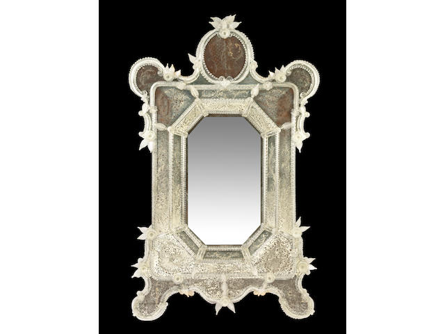 A Venetian reverse etched and applied Murano glass mounted pier mirror