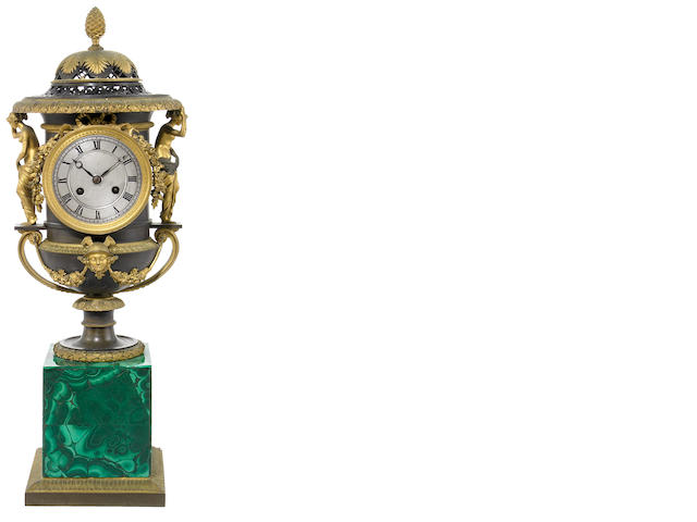 A Regence style gilt and patinated bronze and malachite mantel clock <br>after a model by Pierre-Philippe Thomire