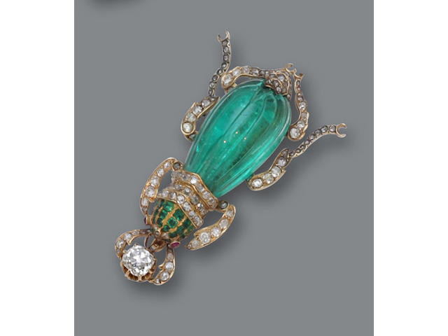 An emerald, diamond and ruby brooch