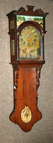 A Dutch Fresian painted, parcel ebonized and gilt oak dubbelkaps staartklok with automaton