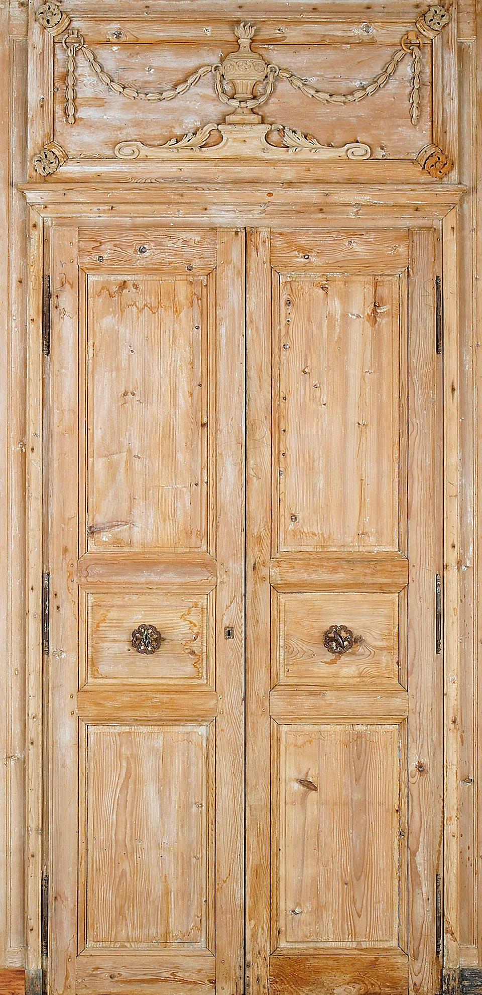 Two pairs of Louis XVI pine doors within door surrounds  last quarter 18th century