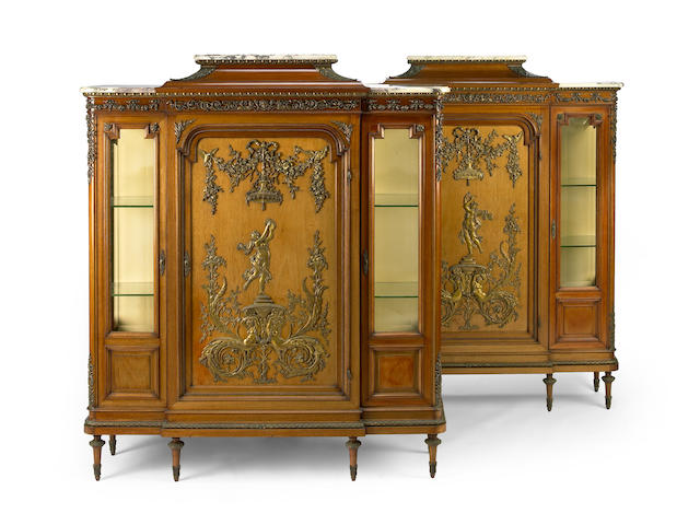 A pair of Louis XVI style gilt bronze mounted mahogany vitrines  fourth quarter 19th century