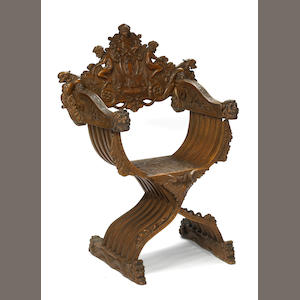 A Baroque style ornate carved walnut Savonarola chair