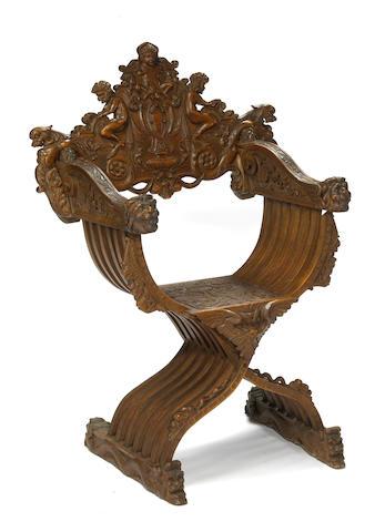 A Baroque style ornate carved walnut Savonarola chair