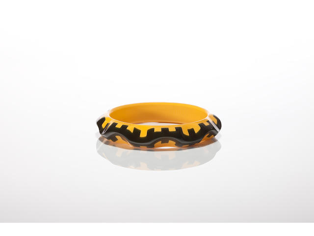 A green and yellow Bakelite bangle bracelet