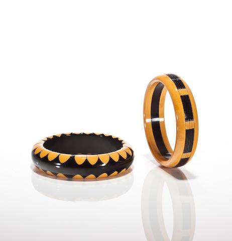 Two black and cream Bakelite bangle bracelets