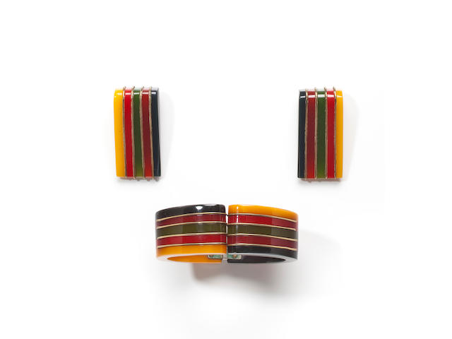 A multi-colored Bakelite laminated hinged bangle bracelet and two brooches
