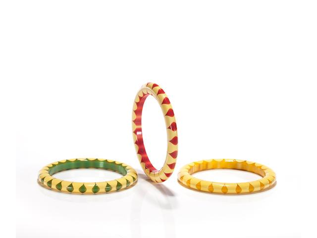 "A group of three Bakelite ""bowtie"" bangle bracelets"