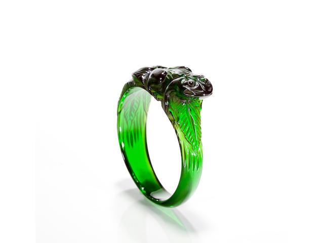 A translucent green Bakelite carved bangle bracelet