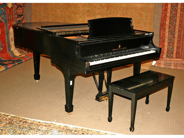 A Steinway ebonized grand piano together with bench