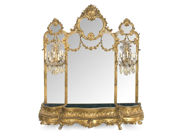 An imposing Napoleon III carved giltwood and gesso hall mirror and associated jardinière  third quarter 19th century