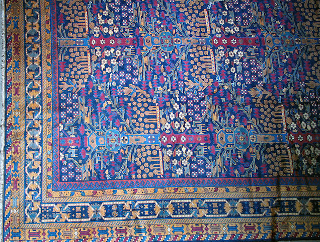 A Samarkand carpet size approximately 10ft. 11in. x 15ft. 3in.