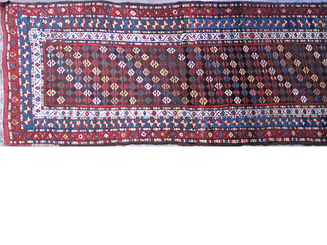 A Caucasian runner size approximately 3ft. 3in. x 11ft. 8in.