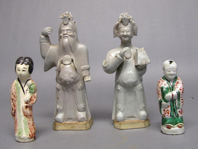 A group of four glazed ceramic figures