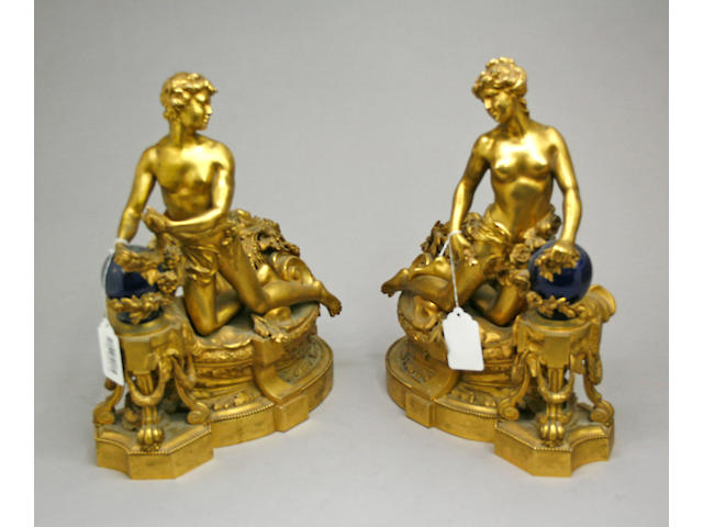 A pair of Louis XVI style gilt bronze figural chenets