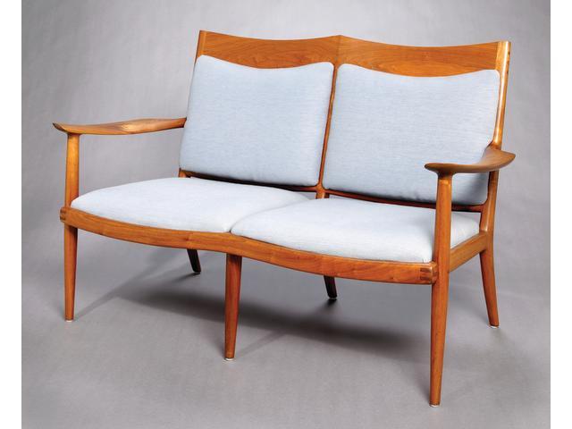 A Sam Maloof two seat Walnut settee