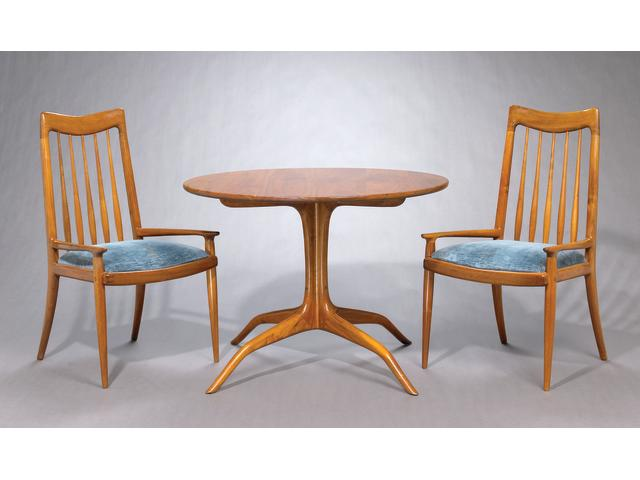 A Sam Maloof walnut circular breakfast table and four back chairs